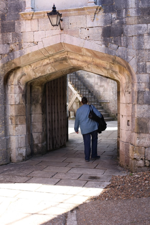 Jackie walking through arch