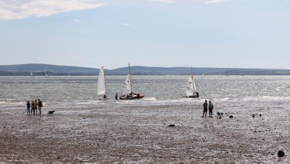 Beach scene with yachts 1