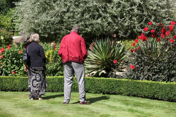Visitors admiring herbaceous border 1