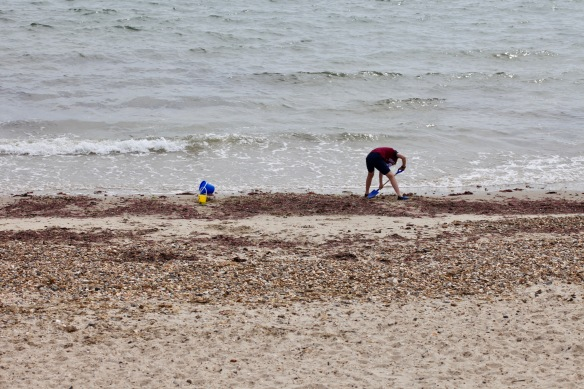 Boy digging in sand 1