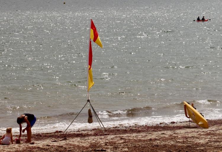 Beach scene with rowers