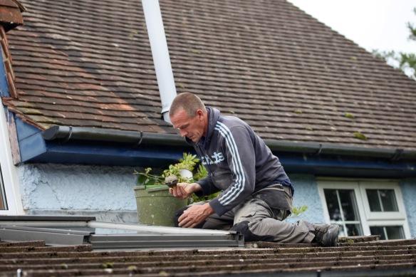 Sid mending roof 1