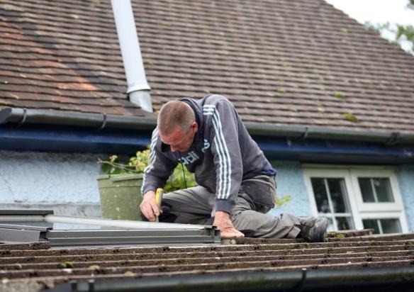 Sid mending roof 2