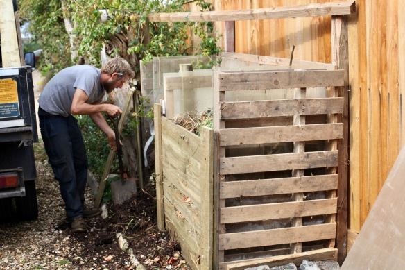 Aaron building compost bins 1