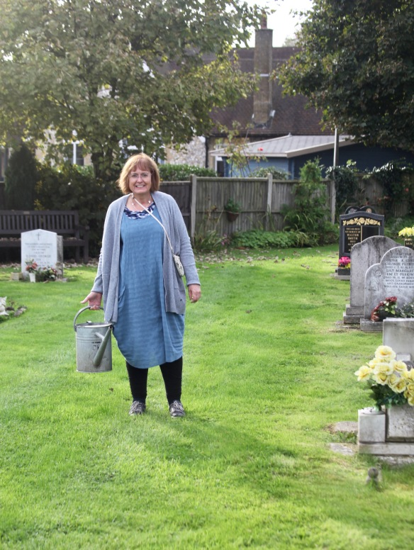 Elizabeth with watering can