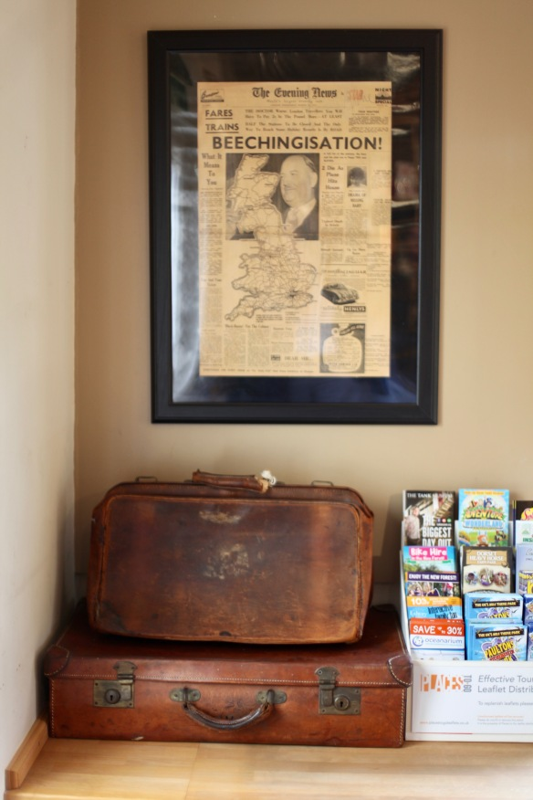 The Evening News and suitcases