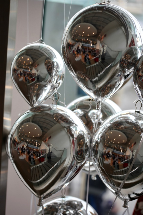 Reflections in silver balloons