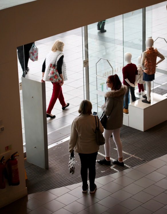 Shoppers in doorway 2