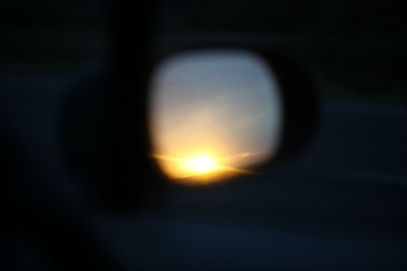 Sunset in wing mirror