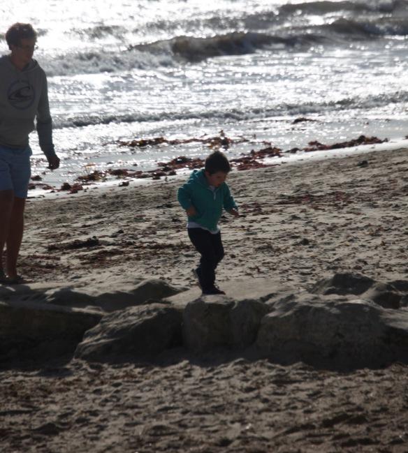 Man and boy on beach 2