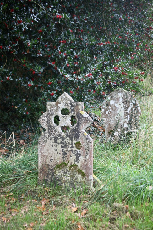 Gravestones, holly