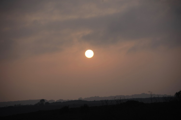 Sun disc over landscape 2