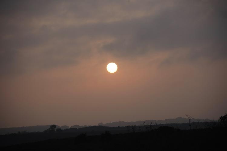 Sun disc over landscape 2
