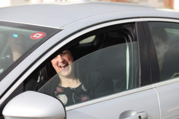 Woman in car laughing