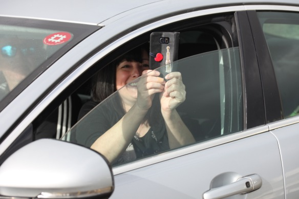 Woman in car photographing