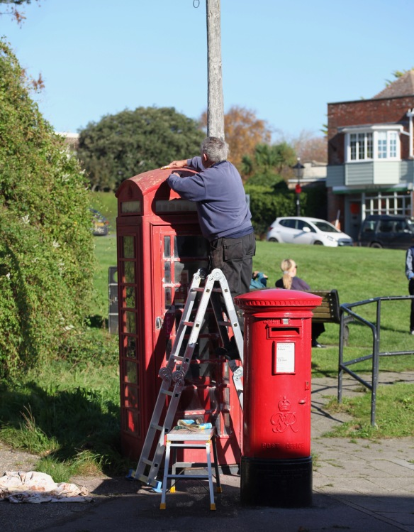 Keith Mitchel refurbishing phone box