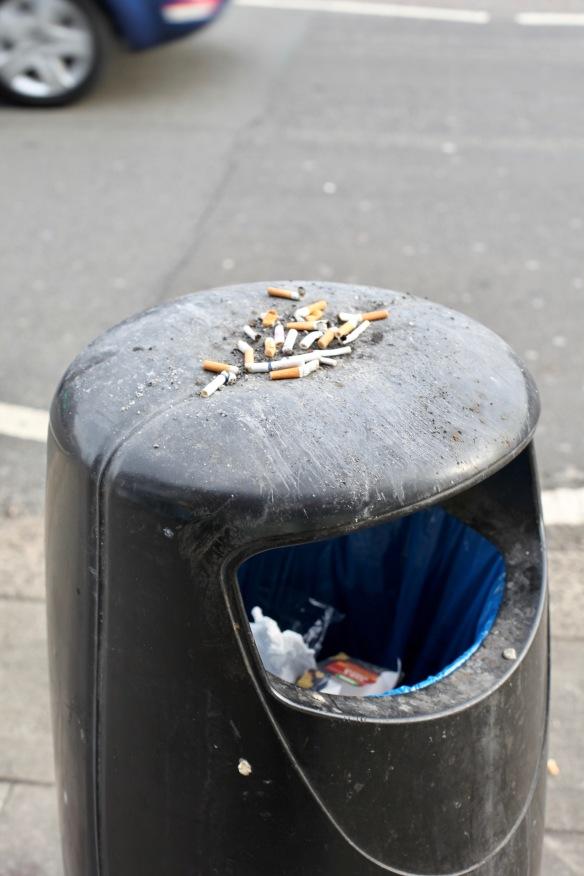 Cigarette ends on litter bin