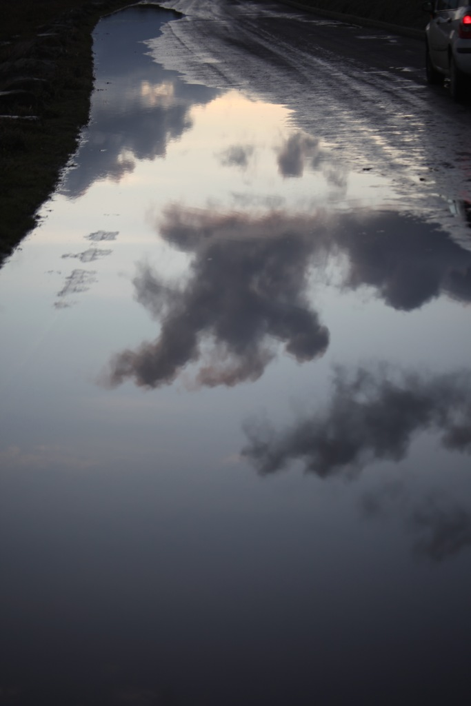 Clouds reflected in pool