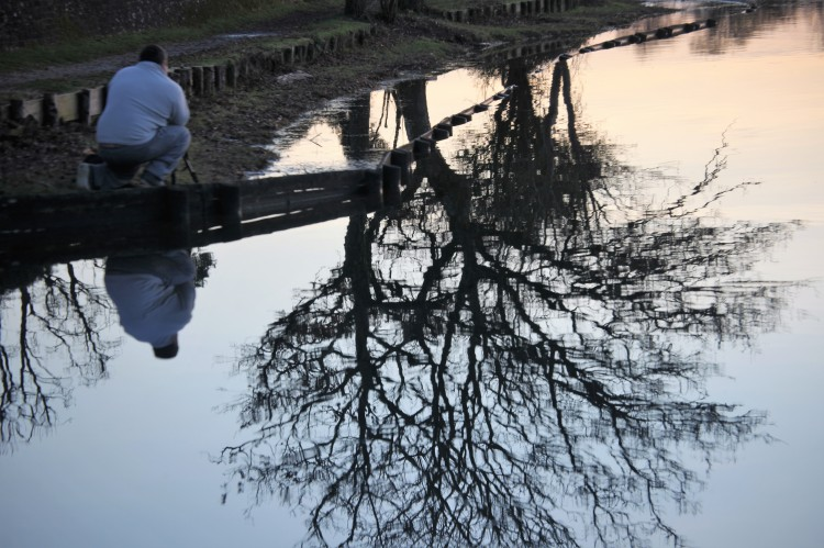 Tree and man reflected
