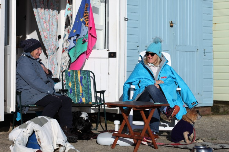 Women at beach hut