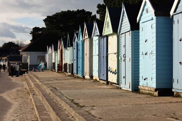 Beach huts, women outside one