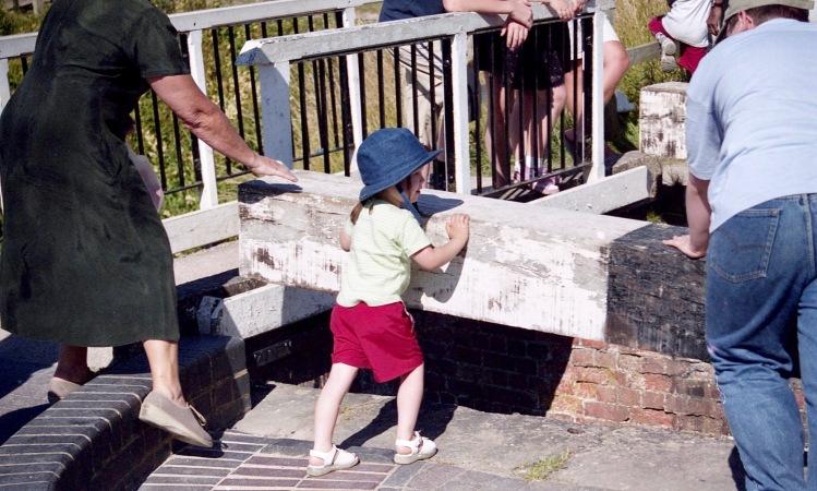Child helping at the locks 7.03
