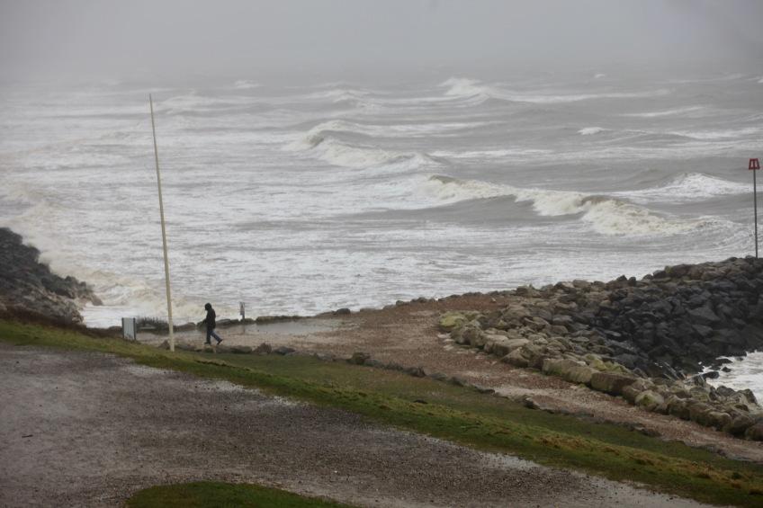 Walker, waves, bent flagpole