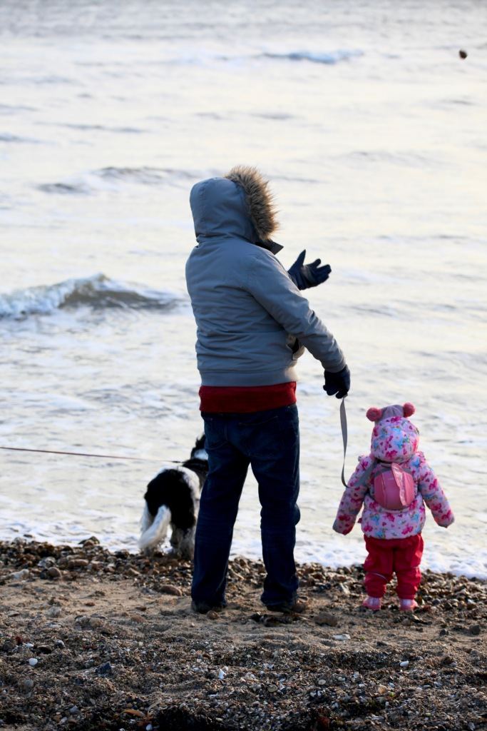 Mother and child throwing stones