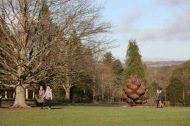 Walkers and pine cone sculpture