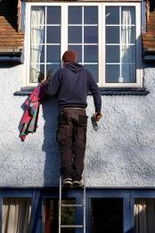 Aaron cleaning windows 3