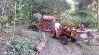 Tractor delivering mulch