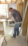 Richard cutting side of cupboard