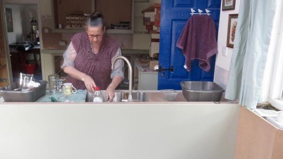Jackie washing up