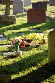 Gravestones and flowers