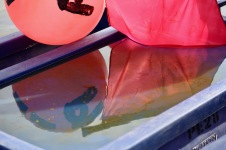 Buoy and flag reflected