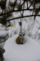 Owl and owlet in snow