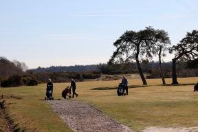 Golfers preparing to cross Burley Road