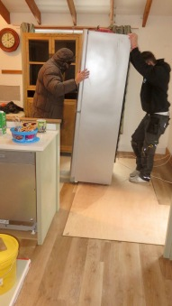 Conor and Andy moving fridge