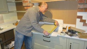 Richard measuring cupboards