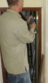 Richard drilling for door hinge