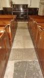 Gravestone paving, North chapel altar, box pews