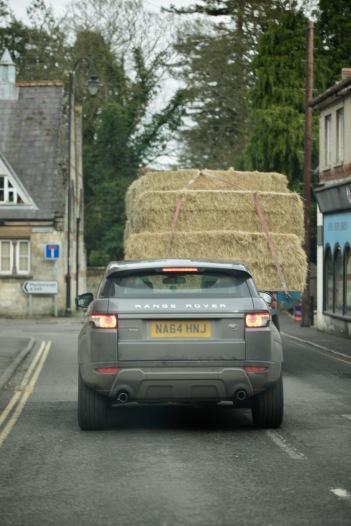Range Rover behind hay truck