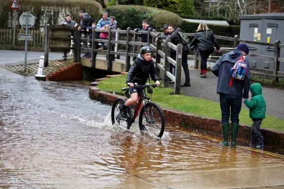 Cyclist going through ford
