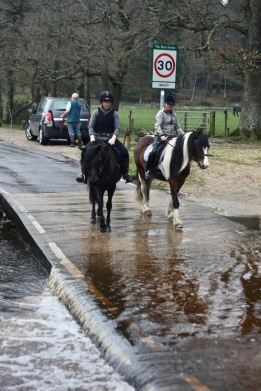 Riders crossing ford