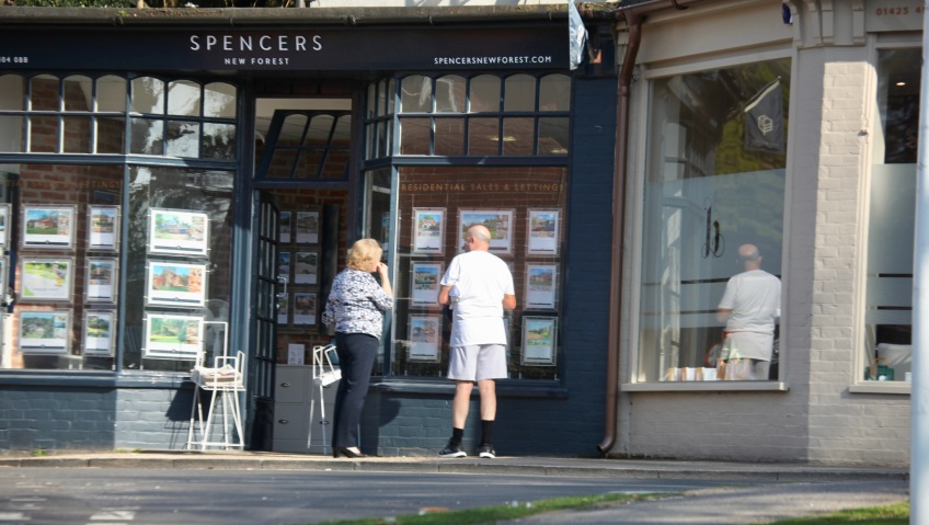 Couple at Spencers window, reflection