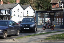 Cars and motorcyclist