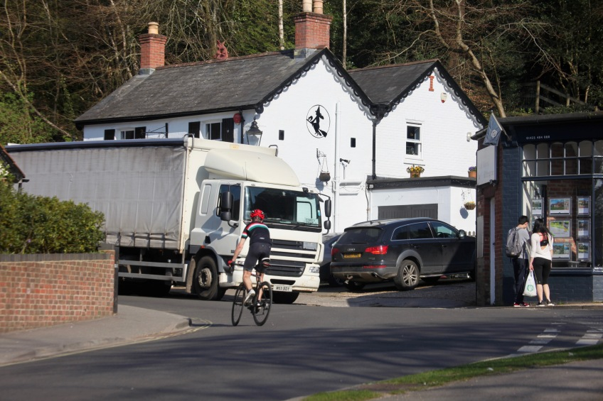 Cyclist, lorry, couple at Spencer's window