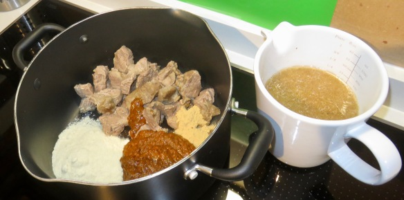 Cooking meat, spices, stock
