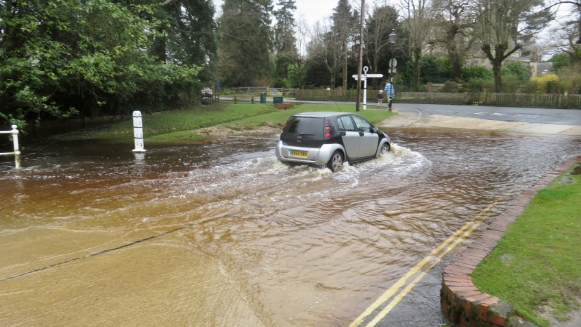 Car going through ford