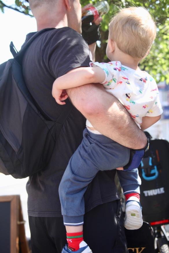 Man carrying toddler